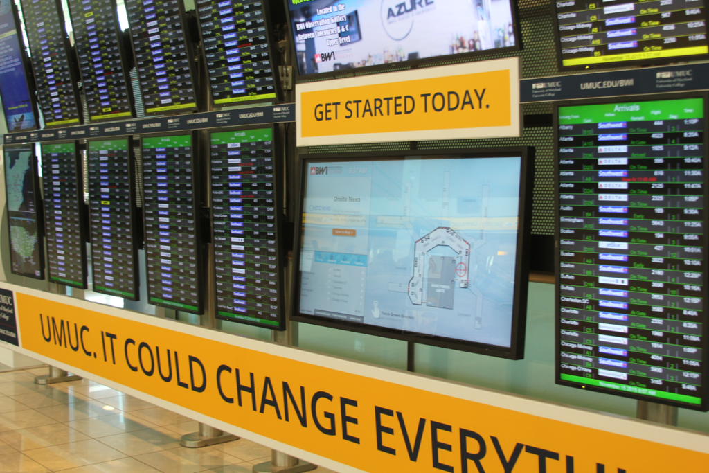 Wide view of BWI International Airport Interactive Digital Sign in the midst of existing FIDS display