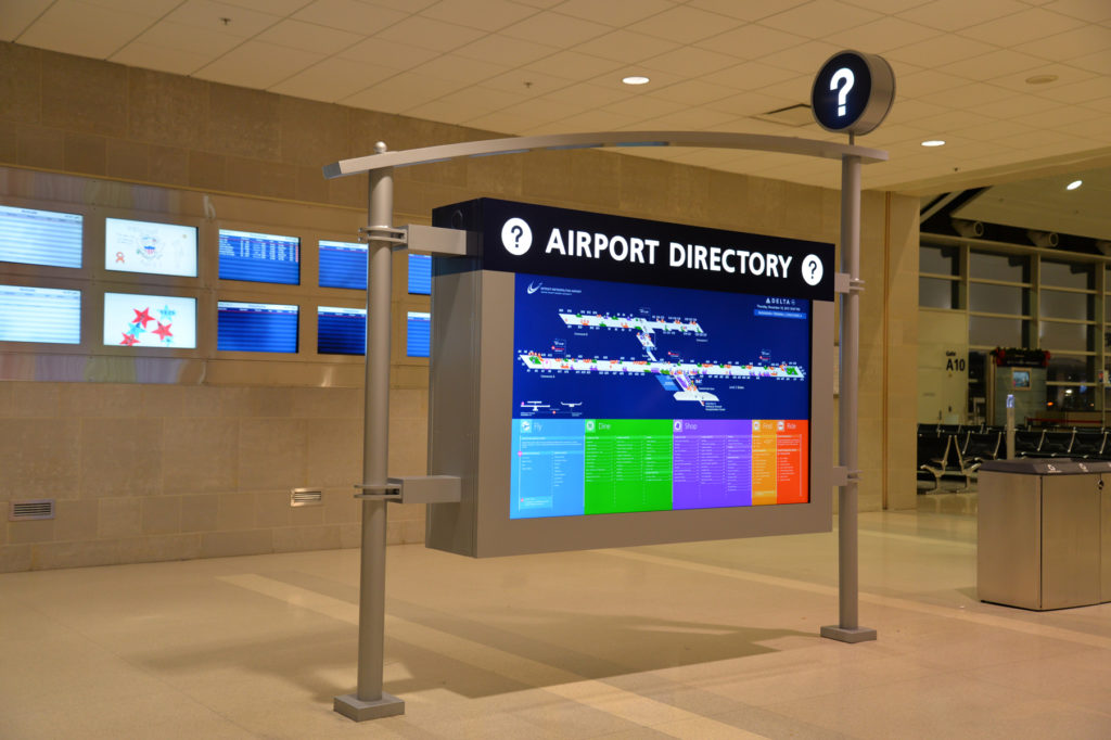 86 inch screen displaying digital signage in DTW Terminal A